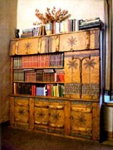 The bookcase he designed and carved for daughter Eya in Taos